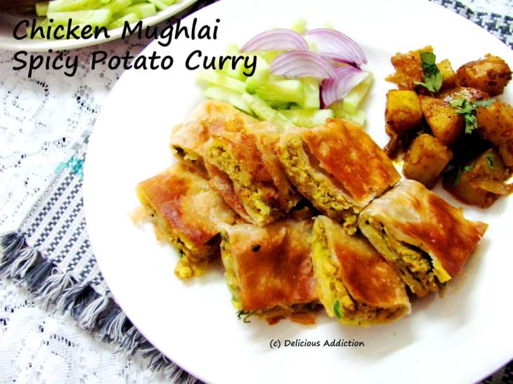 chicken-mughlai-paratha-spicy-potato-curry-indian-bread-with-egg-and-chicken-filling.87384.jpg