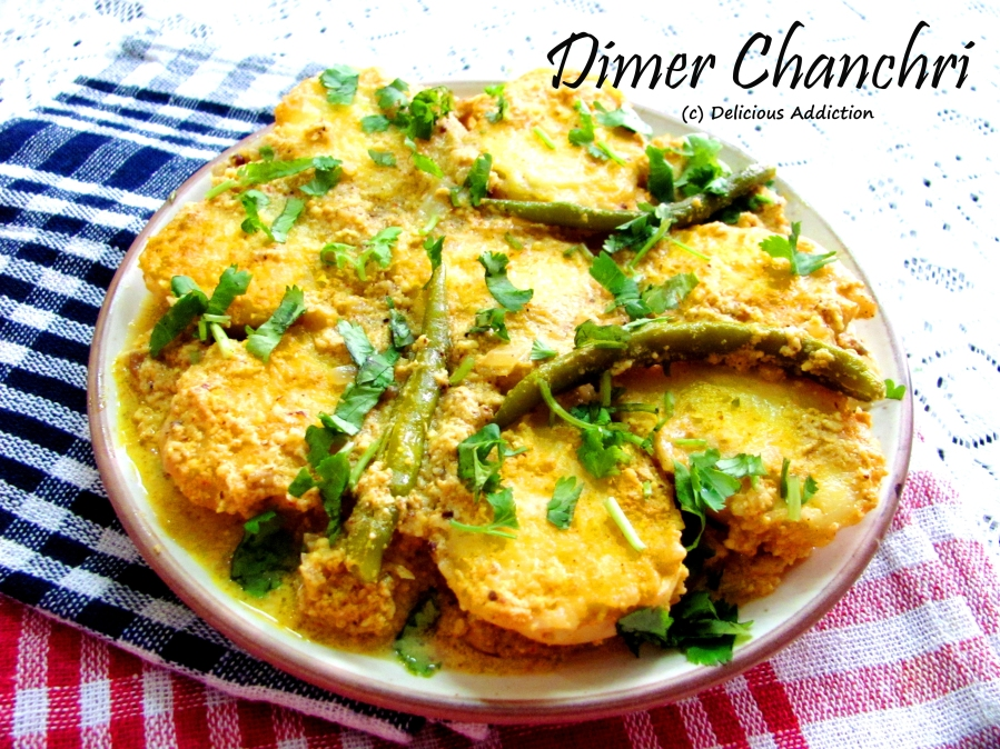 Dimer Chanchri (Egg Cooked in Coconut and Mustard Paste)