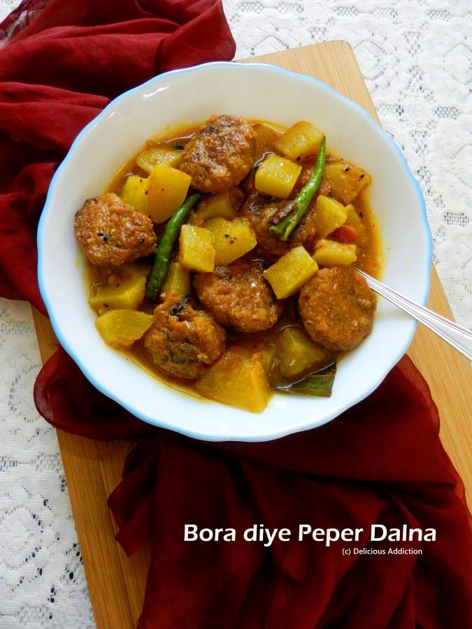Bora diye Peper Dalna (Raw Papaya Curry with LentilFritter)